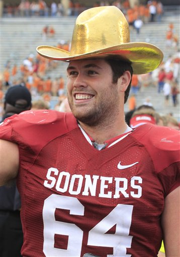Oklahoma offensive linesman Gabe Ikard (64) wears the golden hat trophy after the Sooners beat Texas 63-21 in an NCAA college football game at the Cotton Bowl Saturday, Oct. 13, 2012, in Dallas. (AP Photo/LM Otero)