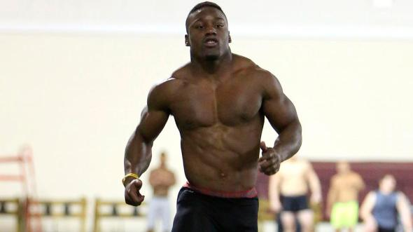 FLEET OF FOOT: Undrafted Patriots rookie running back Roy Finch runs the 40-yard dash at the University of Oklahoma Pro Day in March. He recorded a time of 4.4.
